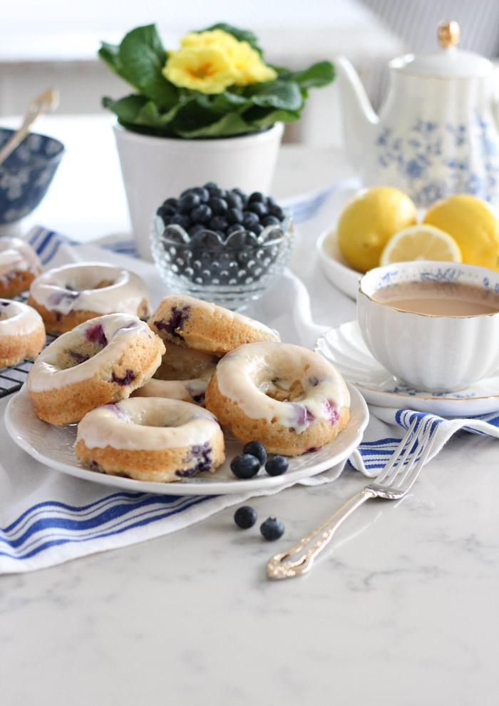 Homemade Blueberry Lemon Donuts Stacked on White Plate
