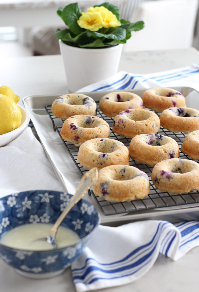 Gluten Free Baked Blueberry Lemon Donuts on Cooling Rack