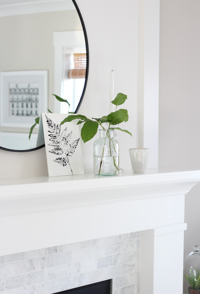 Classic White Fireplace with Painted MDF Mantel and Marble Subway Tile Surround