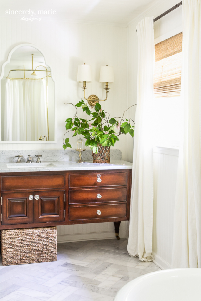 Simply White Bathroom with Vintage Wood Cabinet - Sincerely, Marie Designs Home Paint Colours
