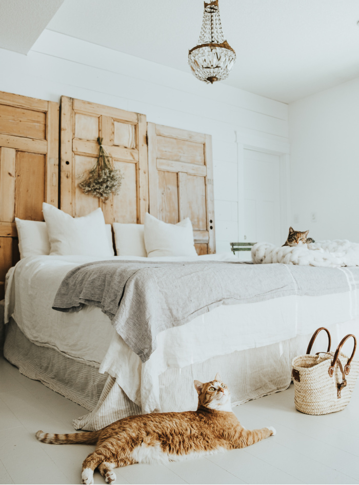 White Master Bedroom with Vintage Doors Headboard - Vintage Society Co.