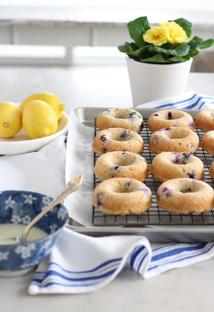 Gluten Free Blueberry Donuts with Lemon Glaze on Cooling Rack