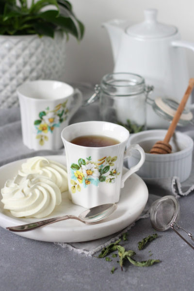 Dried Mint Tea in Floral Tea Cup with Meringue Cookies