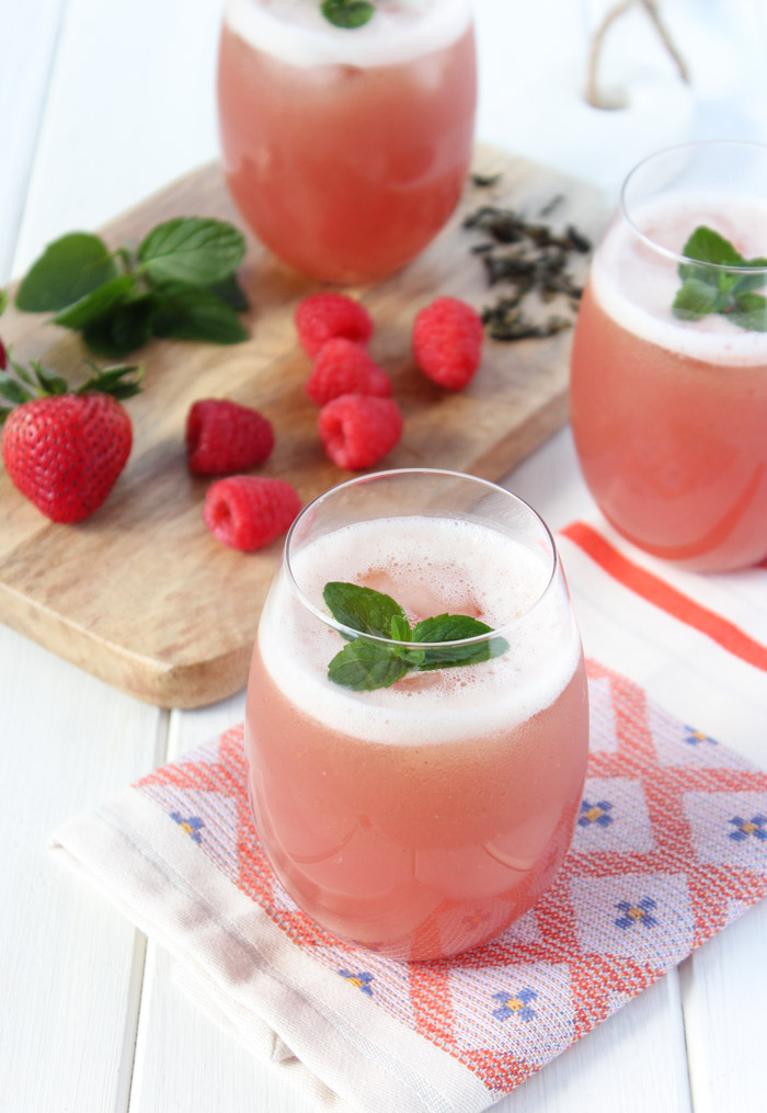 Homemade Iced Green Tea with Berries and Fresh Mint in Glasses