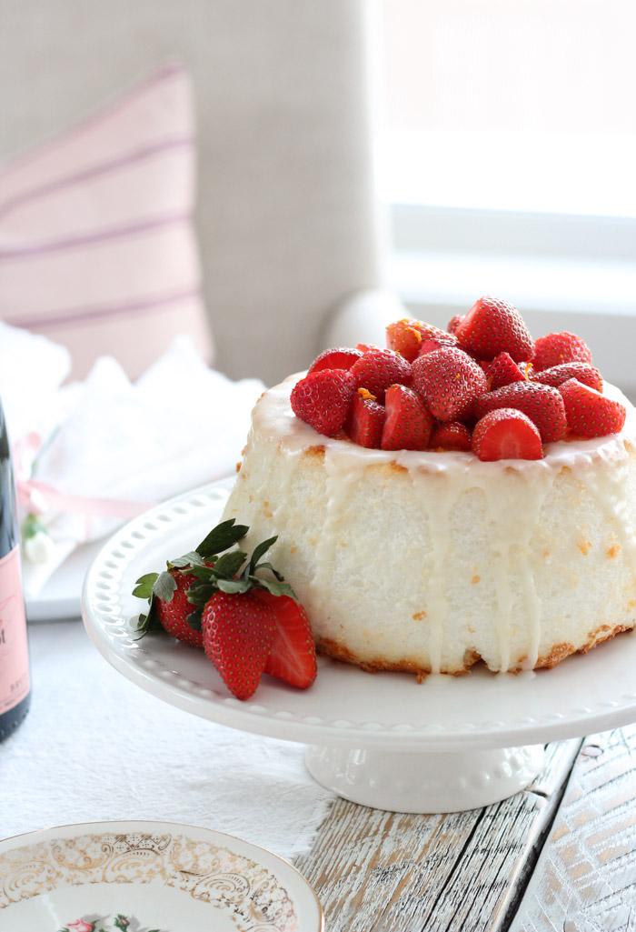 Strawberry Orange Angel Food Cake on White Cake Stand