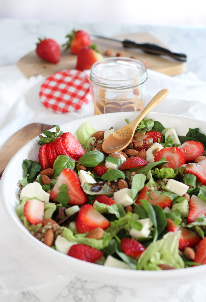 Strawberry Spinach Quinoa Salad with Balsamic Basil Dressing in White Salad Bowl