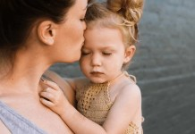 Mother affectionately kissing her daughter after trauma