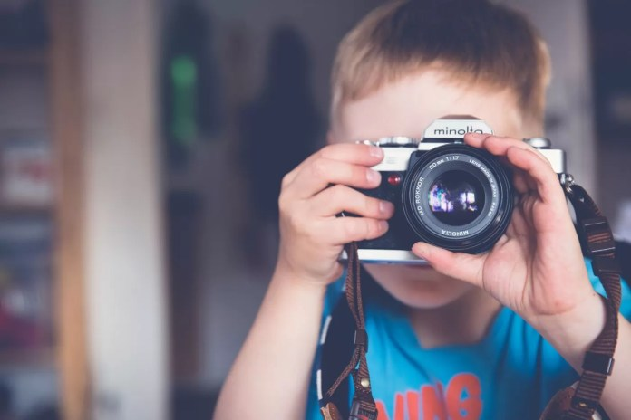 Boy capturing images with a Camera