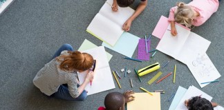 Five children indulged in drawing