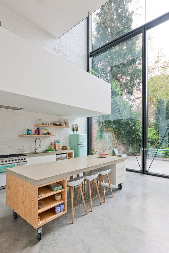 contemporary house features an open plan and a kitchen island with wheels