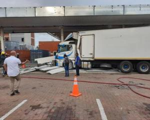 WATCH: Truck driver crashes in garage to avert disaster