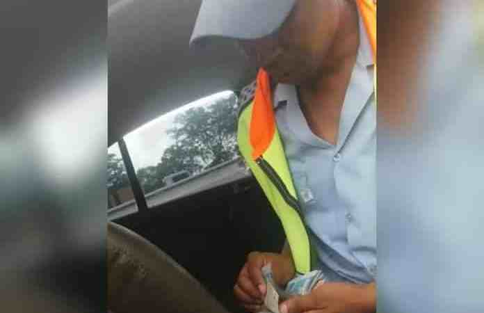 WATCH   Traffic officer in viral bribery video resigns