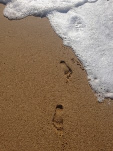 feet in the sands of the ocean