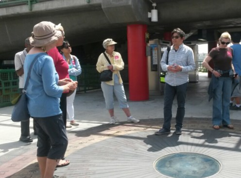 Artist Sam Lee conducted the tour, beginning with the history of the art at the Chinatown station.