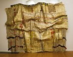 A highllight of the African Textiles exhibit, Man's Cloth is an assemblage of Nigerian liquor bottle labels,beaten flat and stitched together with wires.