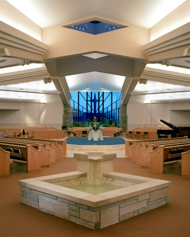 Hand crafted wood pews from Sauder Worship