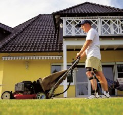 Man mowing the grass wearing orthotic device on the website of Saunders Prosthetics and Orthotics Group in the Villages of Lady Lake