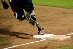 A member of the Wounded Warrior Amputee Softball Team runs around the bases