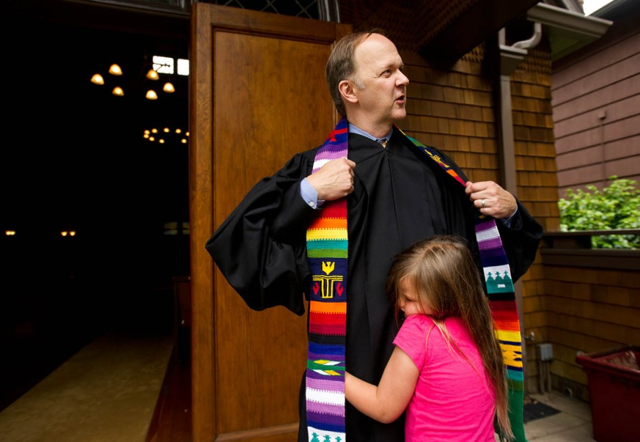 Ellie Mowry-Silverman, 6, hugs dad Rev. Paul Mowry following Sunday service in Sausalito