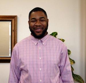 Black man in pink shirt