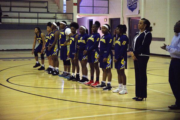 women basketball team and coach