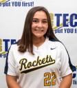 white girl in softball top