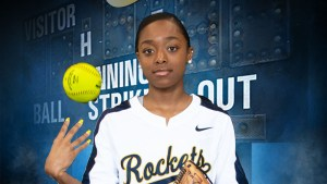softball player with ball