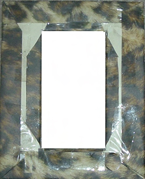 I wrapped decorative paper around to the back of the frame, glued it in place, and trimmed the edges so they'd lie flat.