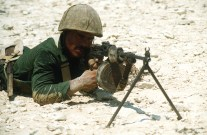 An Egyptian marine aims a Soviet-made RPD 7.62mm light machine gun during an amphibious assault in support of the multinational joint service Exercise Bright Star '85.