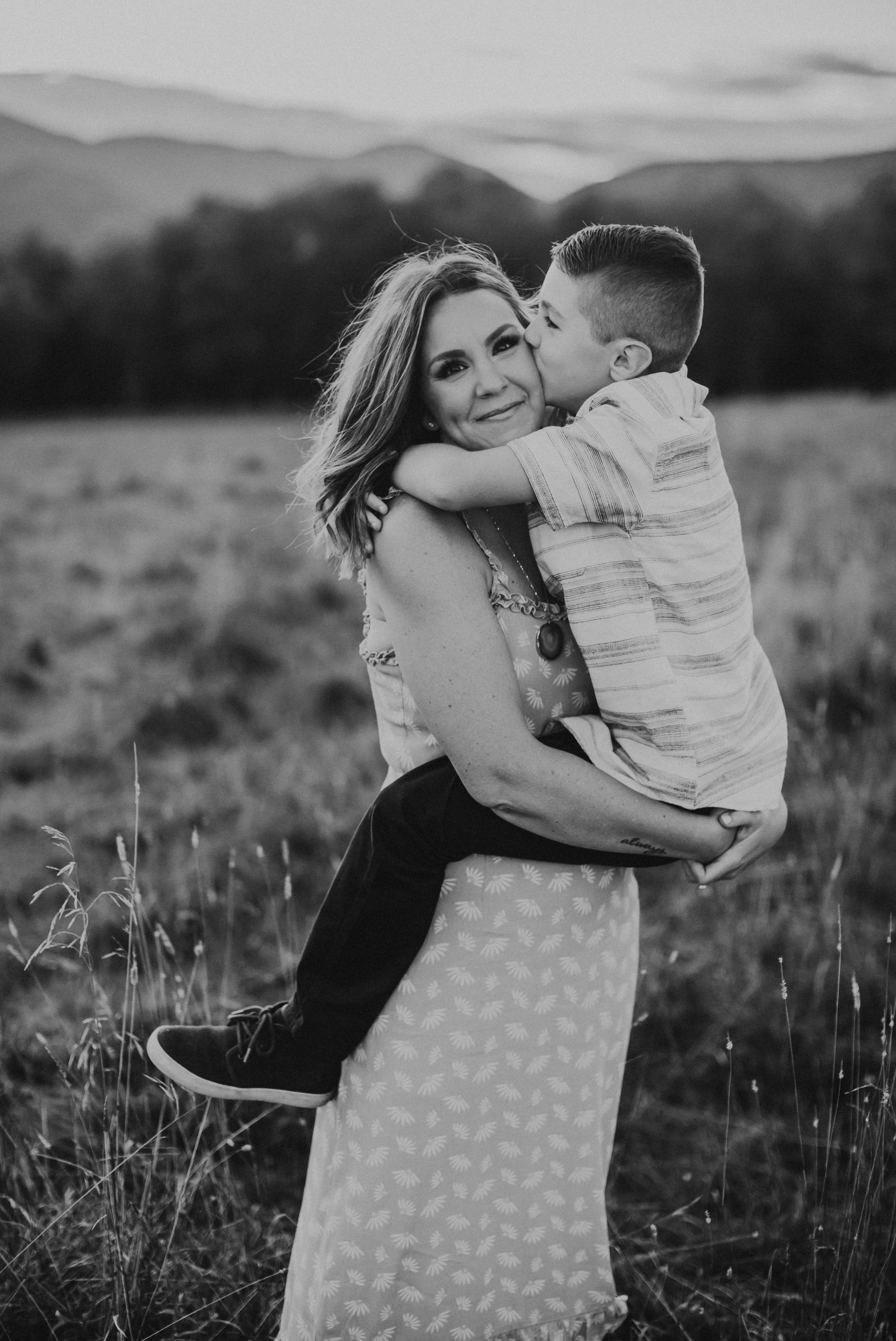 Kid kissing Mom Trapp Lodge