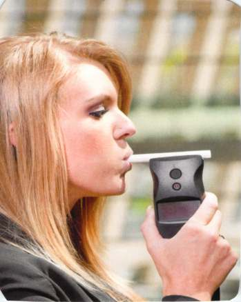 Girl blows in a Preliminary breath test for DUI at roadside