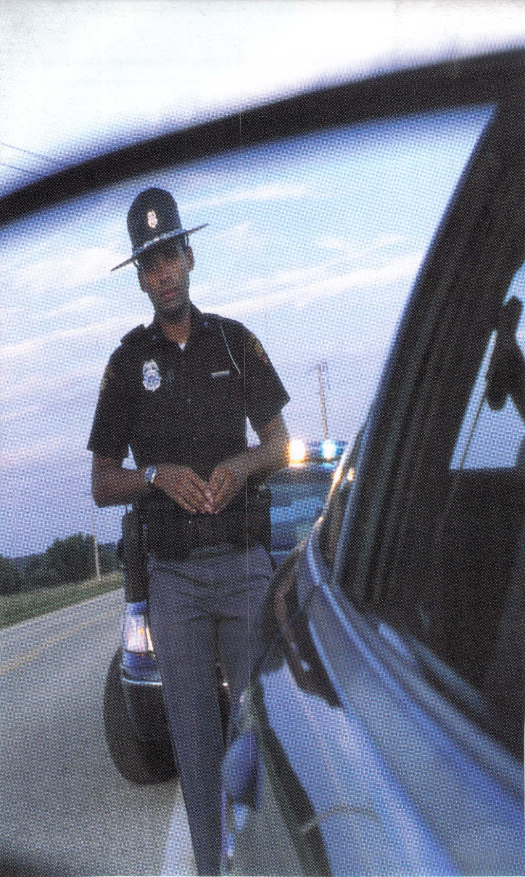 Savannah Police Officer in the mirror at DUI Stop