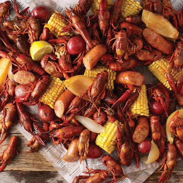 Picture of a crawfish boil with crawfish, corn, and potatoes