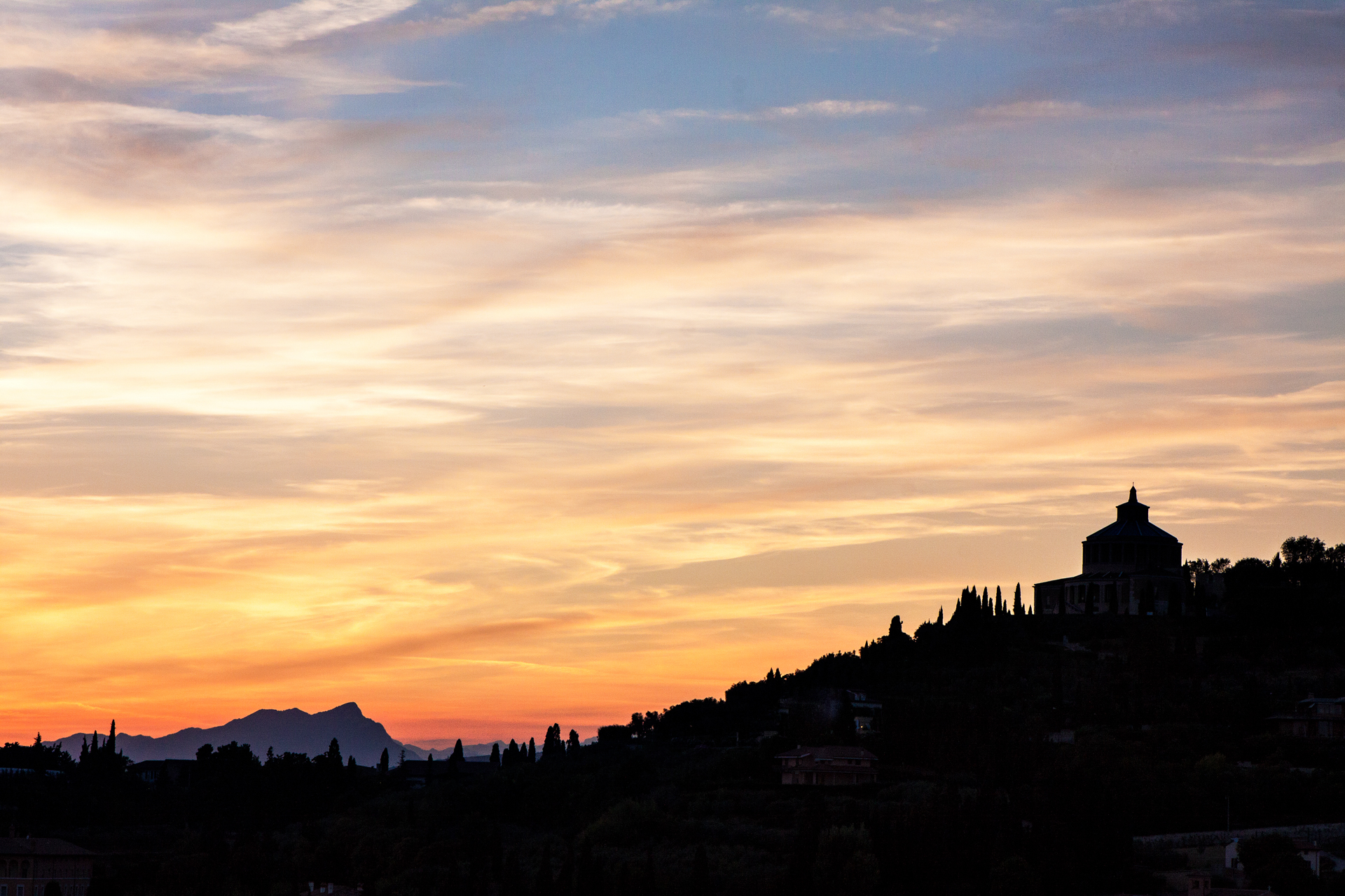 Verona, Italy Sunset with Mountains and Silhouette