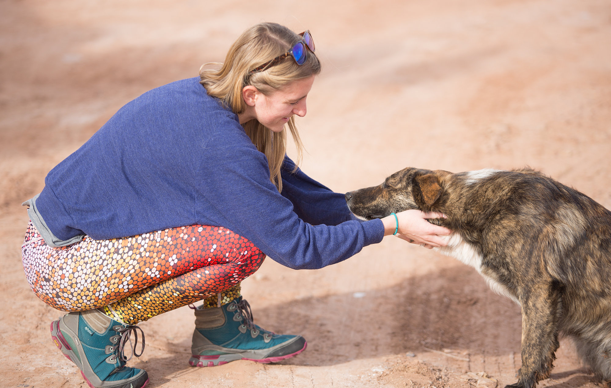 Savannah rescues a stray dog, Puddle, outside of Tuba City, Arizona