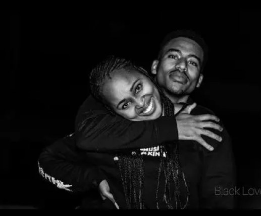 Mzi and his girlfriend serve goals