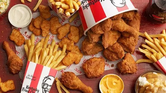 Two men have been arrested after two years of enjoying free meals at KFC posing as health inspectors