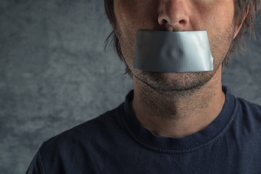 man with mouth taped symbolising censorship