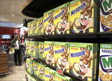 A woman walks past a food display at the company supermarket at the Nestle headquarters in Vevey.
