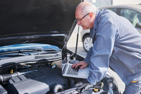 Professional mechanic using contemporary technology at work
