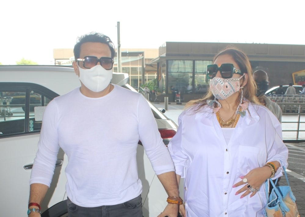 Govinda and his Wife Spotted at Airport Departure
