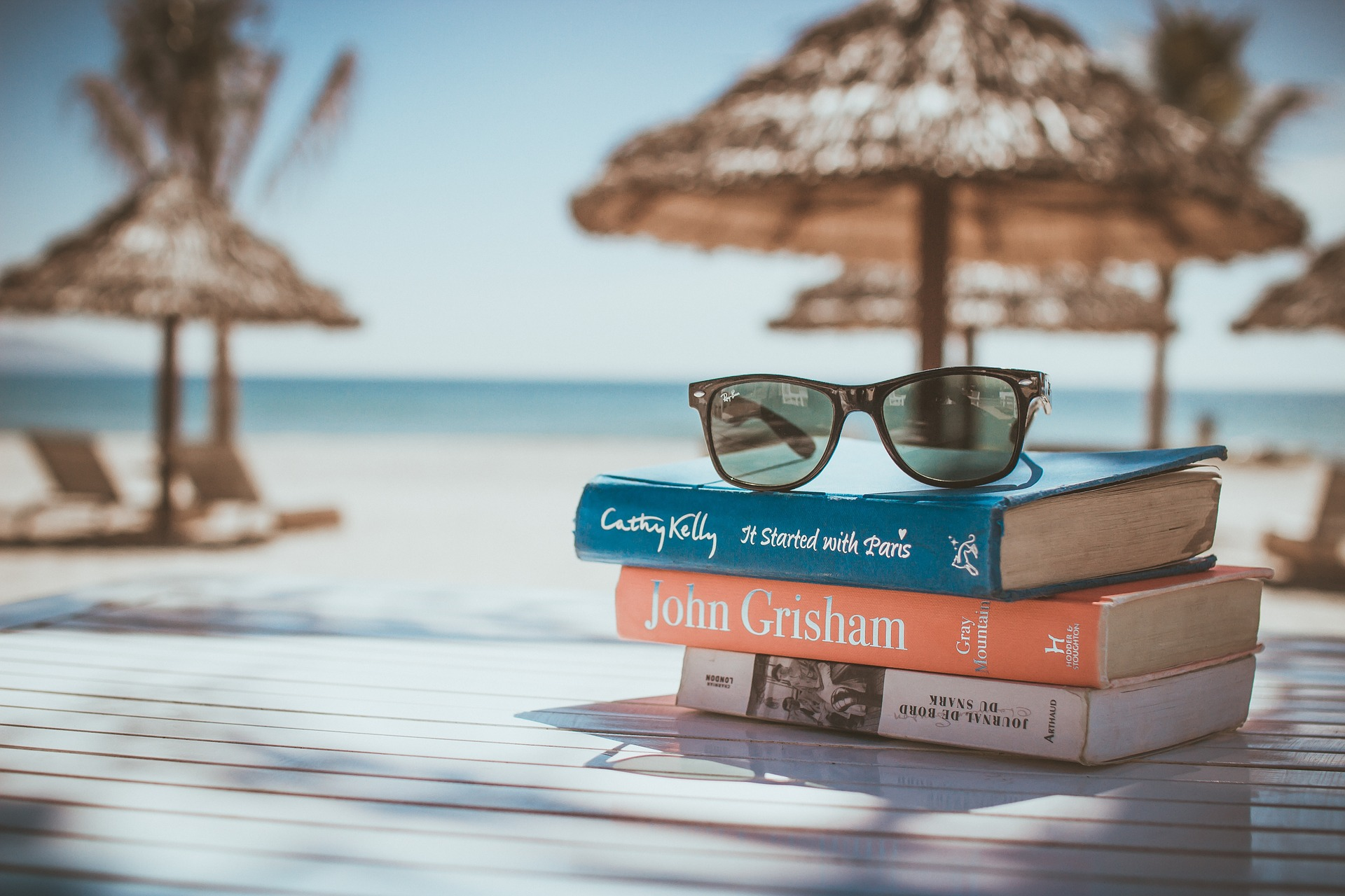 books-sunglasses-beach-spending plan in retirement