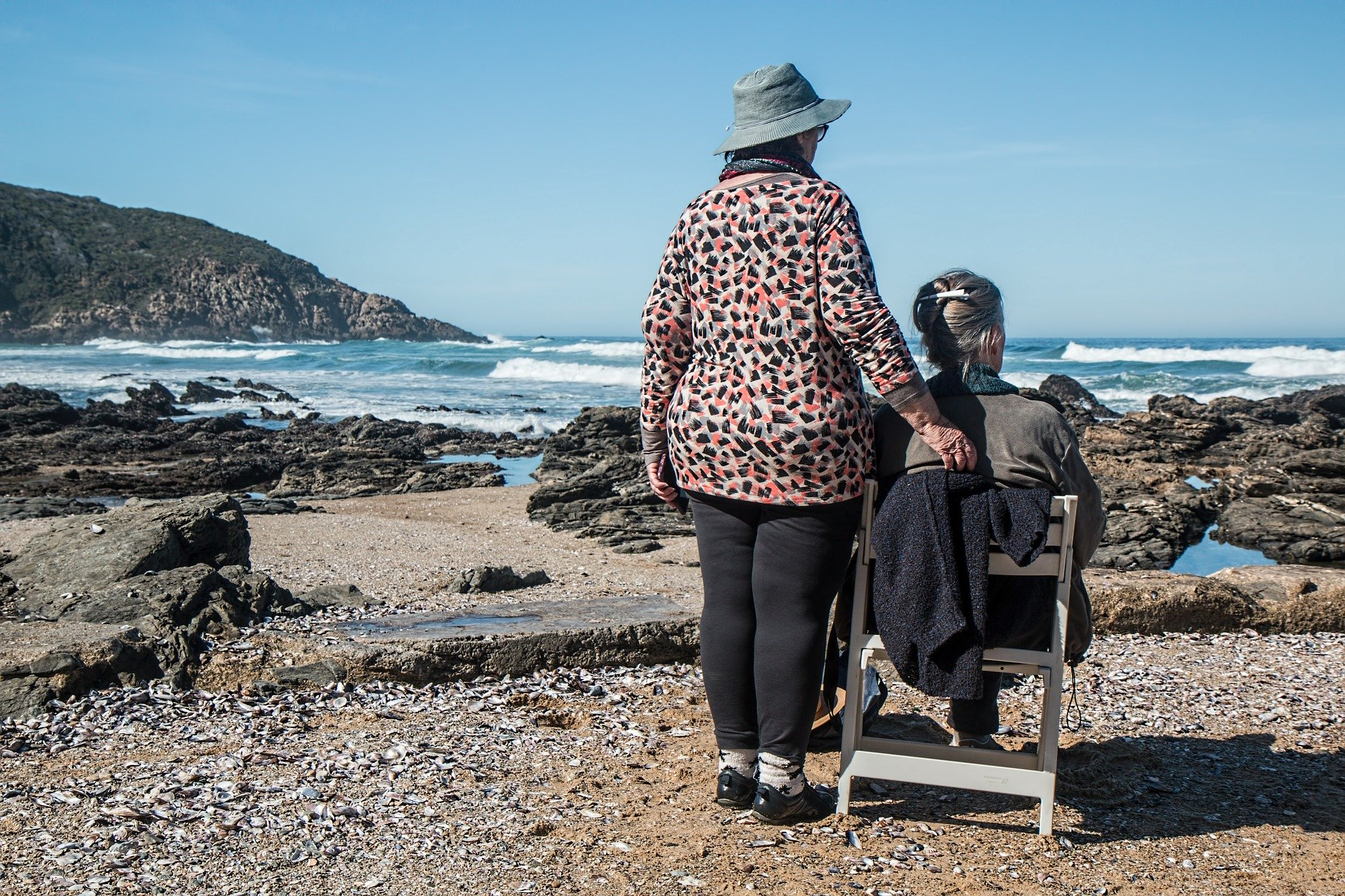 old women- friends next to the sea