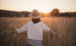 a woman in the field-sunset-emotional stages of retirement
