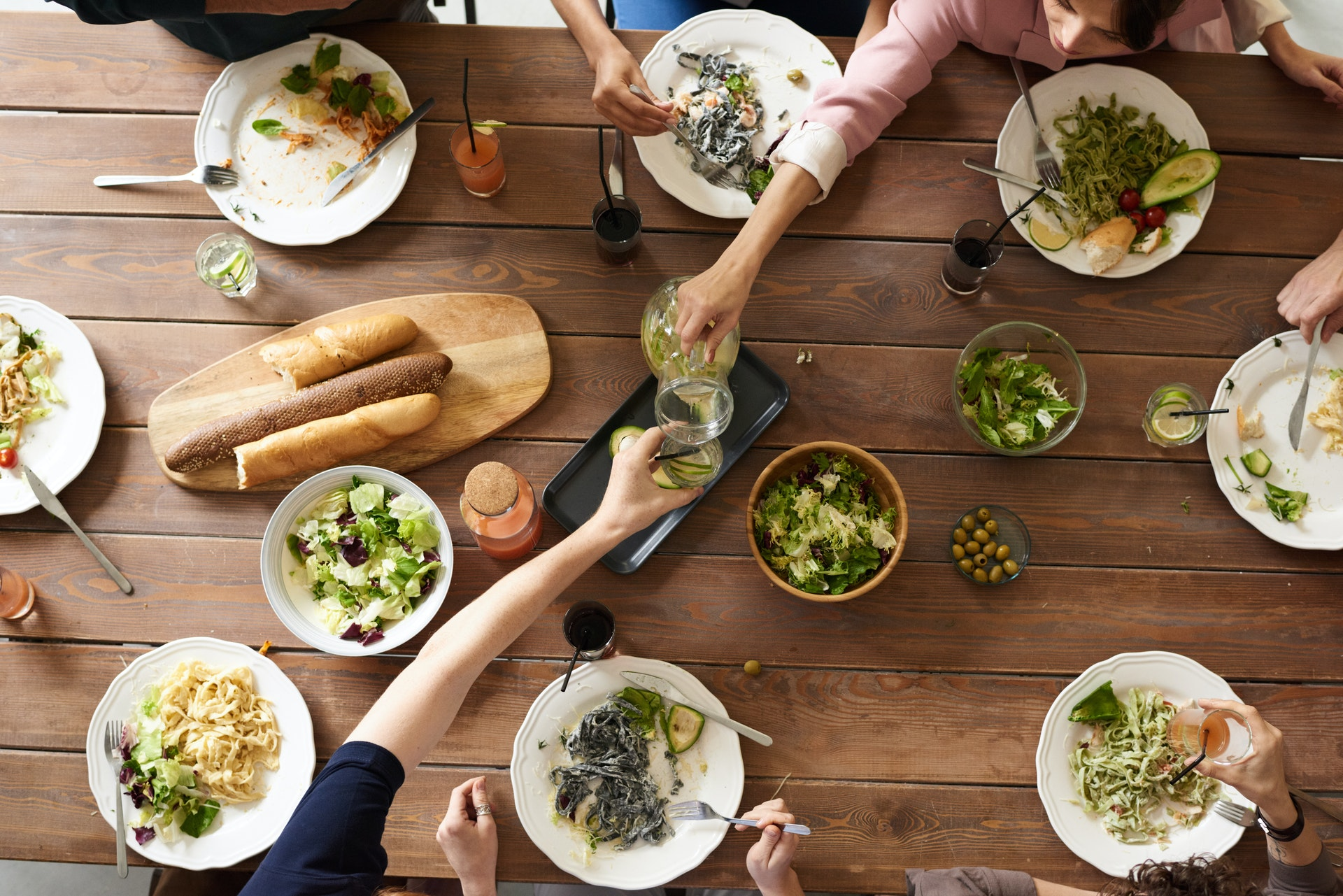 a table with dishes - cooking as a retirement hobby - 15 ideas on what to do when you are retired