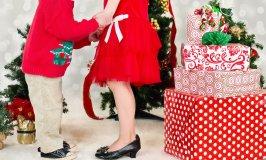 Two kids standing the Christmas tree - Christmas Spirit