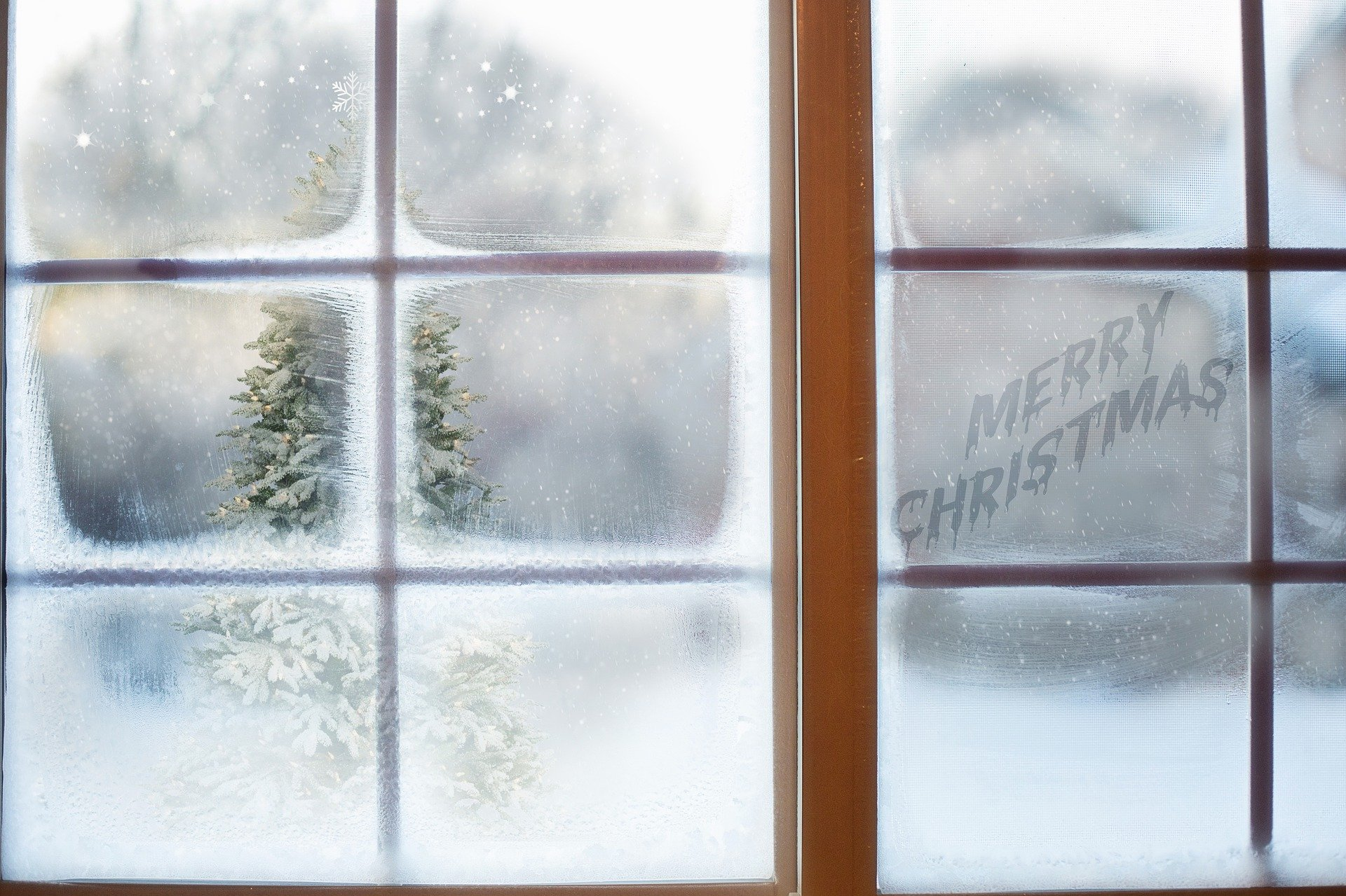 frosted window with Merry Christmas sign - get into the Christmas Spirit