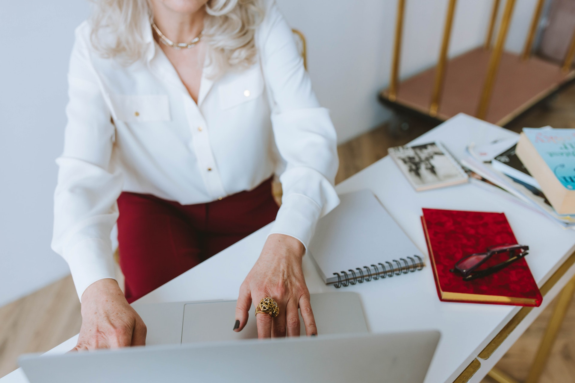 Woman at computer - things to know before you retire