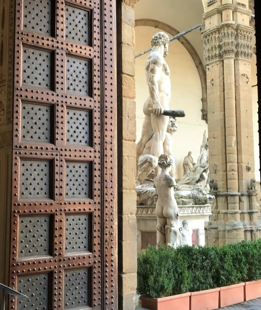 studded door and marble sculptures-highlights of my trip to Florence