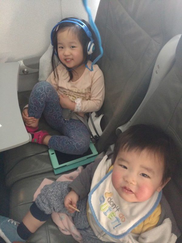 I took my two young kids on the plane as a solo dad. And I survived!